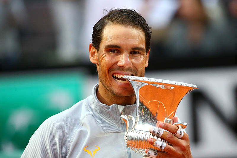 Spain's Rafael Nadal celebrates with the trophy after winning the final. Photo: Reuters