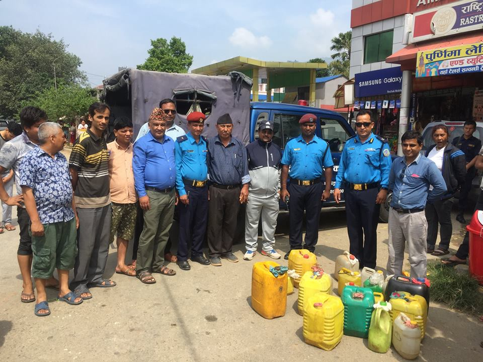 Police team and local representatives destroyed illegal liquor taken under control by the police on Thursday in Dhading.