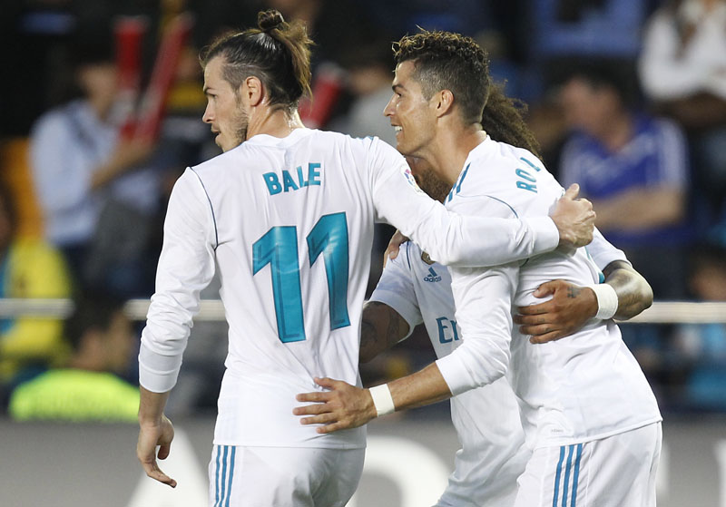 Real Madrid's Cristiano Ronaldo, and Gareth Bale celebrates after Ronaldo scored against Villarreal during a Spanish La Liga  match, at the Ceramica stadium in Villarreal, Spain, on Saturday, May 19, 2018. Photo: Associated Press