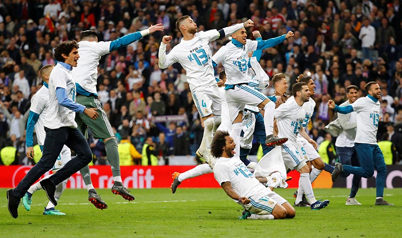 Real Madrid's Sergio Ramos, Marcelo and teammates celebrate after the match during the Champions League Semi Final Second Leg match between Real Madrid and Bayern Munich, at Santiago Bernabeu, in Madrid, Spain, on May 1, 2018. Photo: Reuters