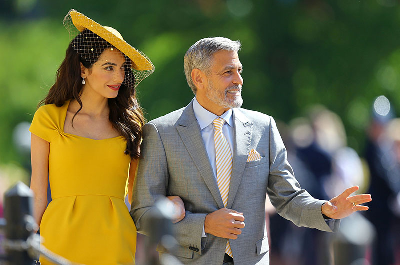 Amal Clooney and George Clooney arrive at St George's Chapel at Windsor Castle for the wedding of Meghan Markle and Prince Harry, on Saturday, May 19, 2018. Photo: Reuters
