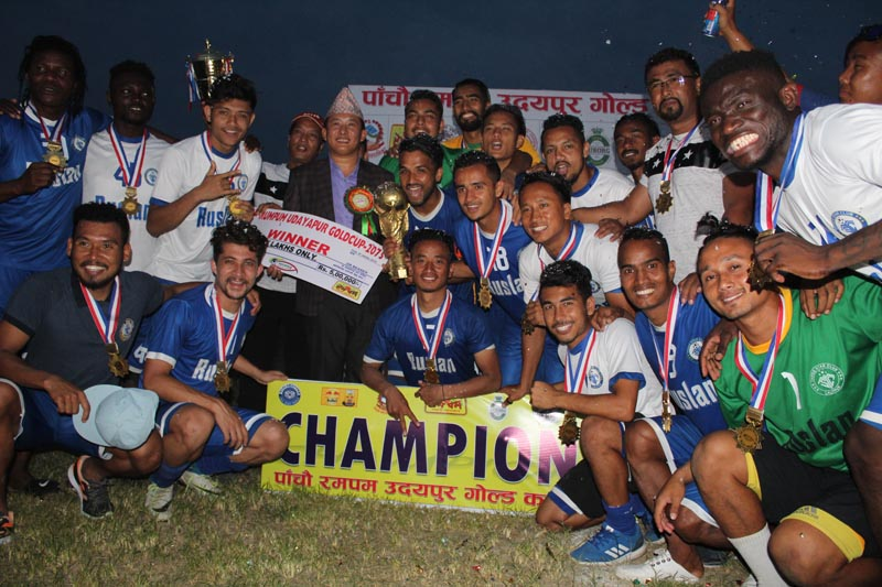 Ruslan Three Star Club players and officials celebrate after winning the fifth Rumpum Udaypur Gold Cup Football Tournament at the Tharuhat Stadium in Gaighat on Saturday, May 19, 2018. Photo: THT