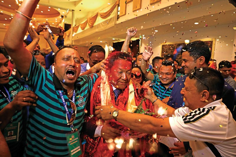 Newly-elected All Nepal Football Association President Karma Tsering Sherpa (centre) celebrates with supporters after the 16th Elective General Assembly in Lalitpur on Saturday,  May 5, 2018. Photo: THT