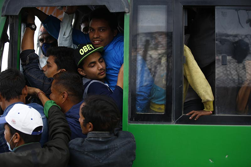 PACKED TO THE GILLS: Passengers packed like sardines in a Sajha Yatayat bus in Kathmandu as public transportation service across the nation was disrupted due to a vehicular strike called by transport entrepreneurs, on Friday, May 4, 2018. Photo: Skanda Gautam/THT