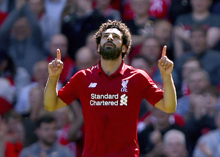 Liverpool's Mohamed Salah celebrates scoring his side's first goal of the game during their English Premier League  match against Brighton & Hove Albion at Anfield, Liverpool. England, on Sunday, May 13, 2018. Photo: Associated Press