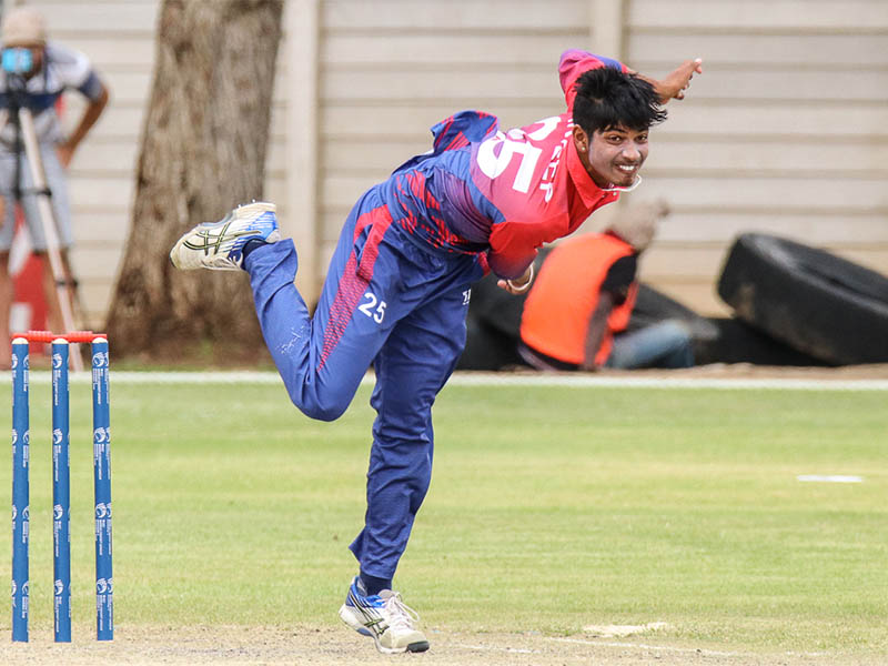 Sandeep Lamichhane whirls through his delivery. Photo courtesy: Cricinfo.com