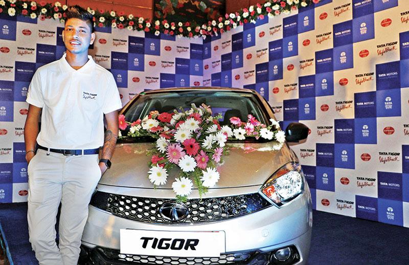 Sandeep Lamichhane poses with the Tata Tigor car in Kathmandu on Wednesday. Photo: THT