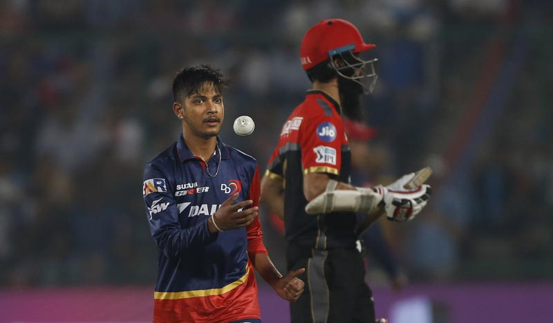 Delhi Daredevils' bowler Sandeep Lamichhane prepares to bowl in his debut match during the VIVO IPL cricket T20 match against Royal Challengers Bangalore in New Delhi, India, on Saturday, May 12, 2018. Photo: AP