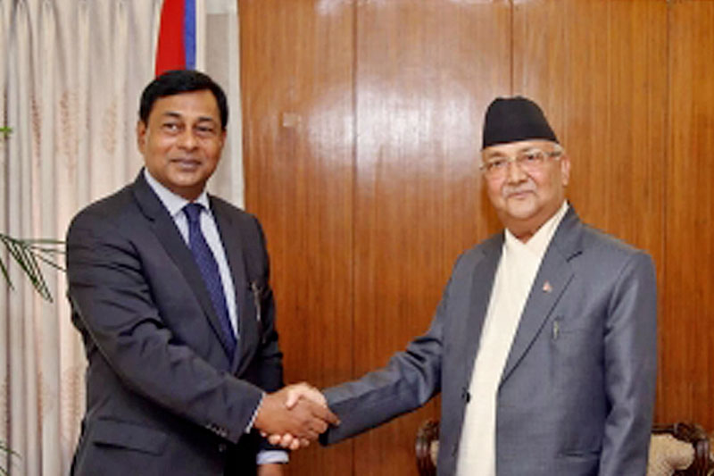 Secretary General of BIMSTEC, Shahidul Islam (left) meets Prime Minister KP Sharma Oli at latter's official residence in Baluwatar, Kathmandu, on Thursday, May 31, 2018. Photo: RSS
