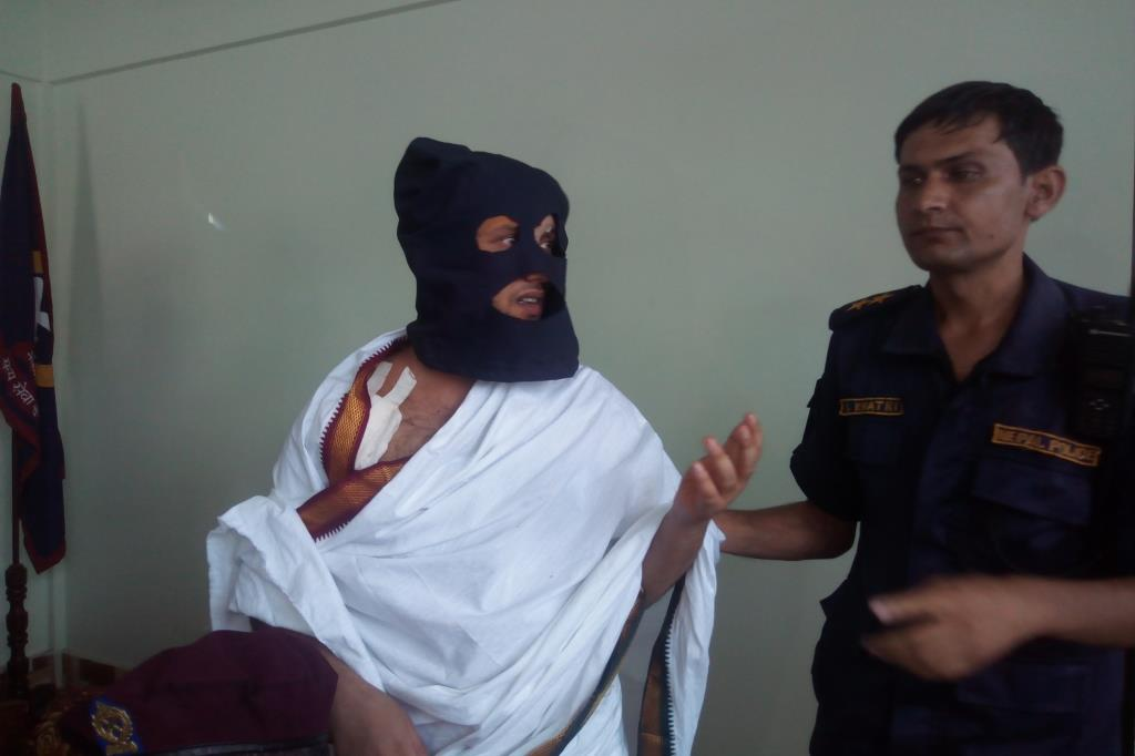 This undated image shows religious leader Shreeniwas Acharya arrested for staging his own shooting. Photo courtesy: Hari Adhikari