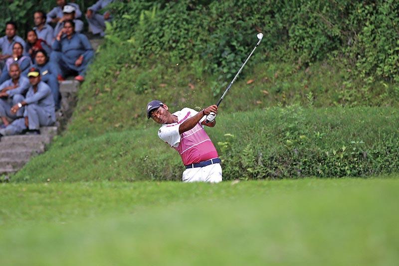 Bhuwan Nagarkoti plays a shot on the third day of the Surya Nepal Premier at Gokarna Golf Club. Photo: Skanda Gautam/ THT