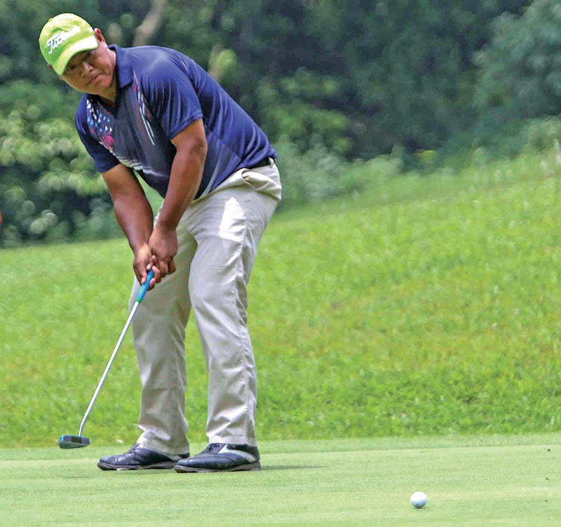 Shivaram Shrestha plays a shot during the second round of the Surya Nepal Premier Golf Championship at the Gokarna Golf Club in Kathmandu on Tuesday. Photo: THT