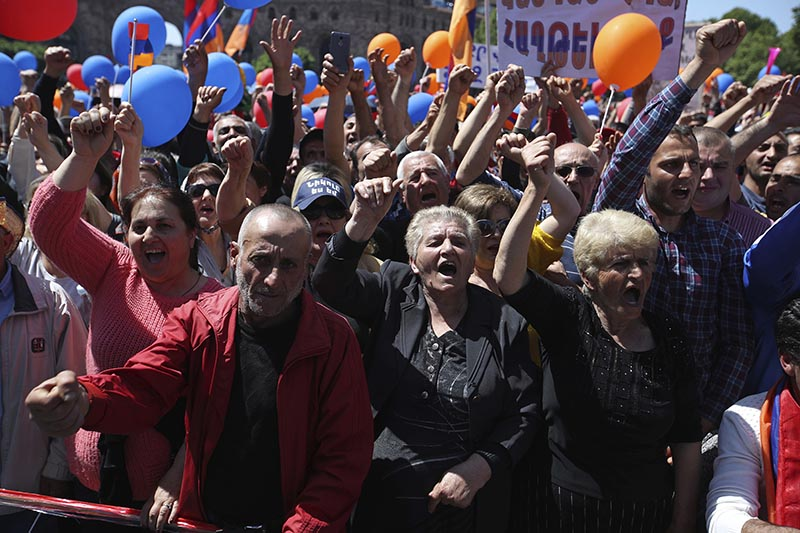 Supporters of the opposition lawmaker Nikol Pashinian shout slogans during a rally at the Republic square in Yerevan on Tuesday, May 1, 2018. Pashinian, who sparked two weeks of protests that threw Armenia into a political crisis, so far is the only candidate formally nominated for the prime minister's post. Photo: AP