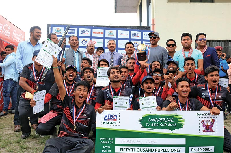 Shankerdev Campus team members celebrate with officials after winning the Univesal TU BBA Twenty20 Cup Cricket Tournament at the Mulpani Cricket grounds in Kathmandu on Tuesday. Photo: THT