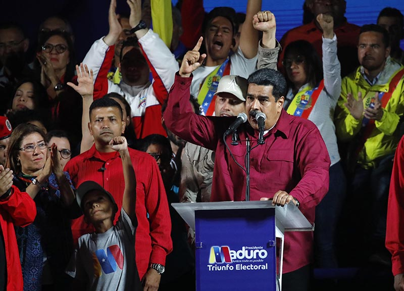 Venezuela's President Nicolas Maduro is surrounded by supporters as he speaks during a gathering after the results of the election were released, outside of the Miraflores Palace in Caracas, Venezuela, on May 20, 2018. Photo: Reuters