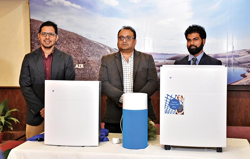 TR Ganesh, general manager of Blueair MiddleEast (centre), launching Blueair indoor air purifiers, in Kathmandu, on Wednesday. Photo: THT
