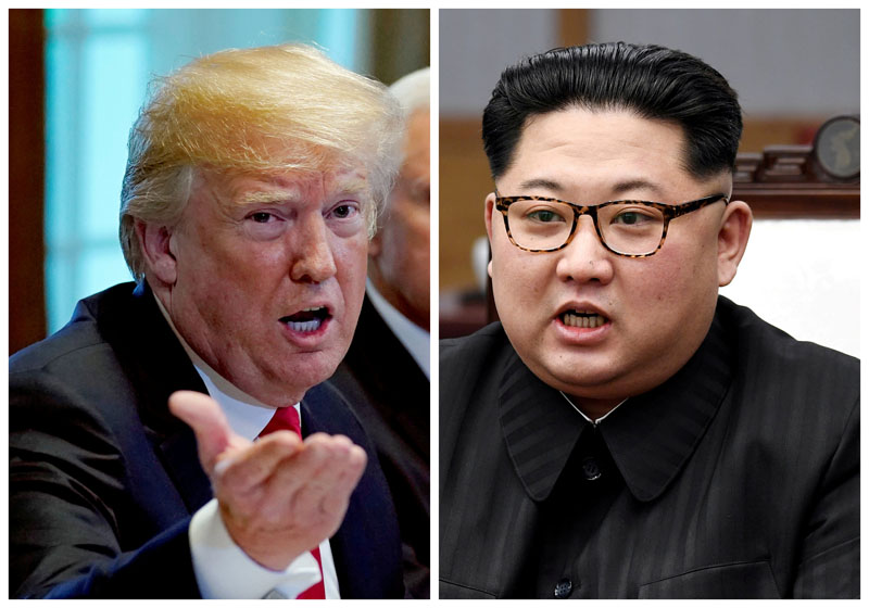 FILE PHOTO: A combination photo shows U.S.  President Donald Trump and North Korean leader Kim Jong Un (R) in Washignton, DC, U.S. May 17, 2018 and in Panmunjom, South Korea, April 27, 2018 respectively.  REUTERS/Kevin Lamarque and Korea Summit Press Pool/File Photos