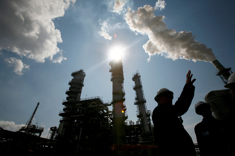 FILE PHOTO:   James Prokupek (L), an engineering department process design manager for the Valero St. Charles Oil Refiner, is seen in silhouette during a tour of the refinery in Norco, Louisiana, U.S., August 15, 2008.  REUTERS/Shannon Stapleton/File Photo