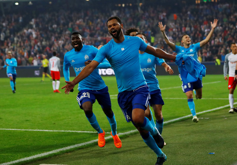 Marseille's Rolando celebrates scoring their first goal with team mates during Europa League Semi Final Second Leg match between RB Salzburg and Olympique de Marseille, at Red Bull Arena, Salzburg, Austria, on May 3, 2018. Photo: Reuters