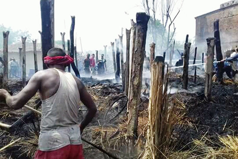 A local man along with fire fighters trying to douse fire at Jayamangalapur in Chiparmai Rural Municipality-3 in Parsa district, on Thursday, May 03, 2018. Photo: Ram Sarraf