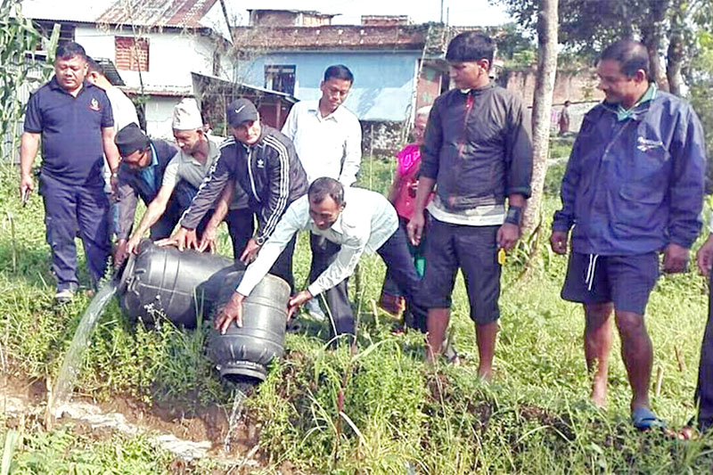 Locals in presence of security personnel destroying local hooch in Tanahun, on Wednesday, May 30, 2018. Photo: Madan Wagle