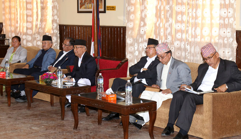 Prime Minister KP Sharma Oli, Nepal Communist Party Co-Chair Pushpa Kamal Dahal among other senior leaders addressing the parliamentarians in a meeting held at PM's official residence, in Baluwatar, Kathmandu, on Tuesday, 22 May, 2018. Photo: RSS