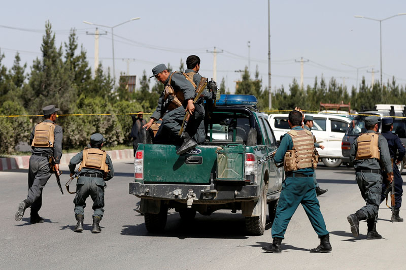 Afghan policemen arrive at the site of an attack in Kabul, Afghanistan May 30, 2018. REUTERS/Mohammad Ismail