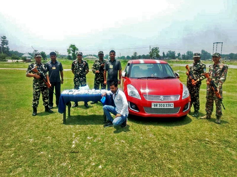 A man along with seized car and illegal silver being made public by Indian SSB in Bagmati Camp, on Monday, May 28, 2018. Photo: Prabhat Kumar Jha