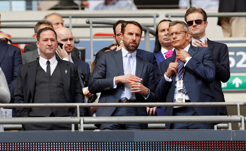 Soccer Football - FA Cup Semi Final - Chelsea v Southampton - Wembley Stadium, London, Britain - April 22, 2018   England manager Gareth Southgate and assistant manager Steve Holland in the stands    REUTERS/Darren Staples