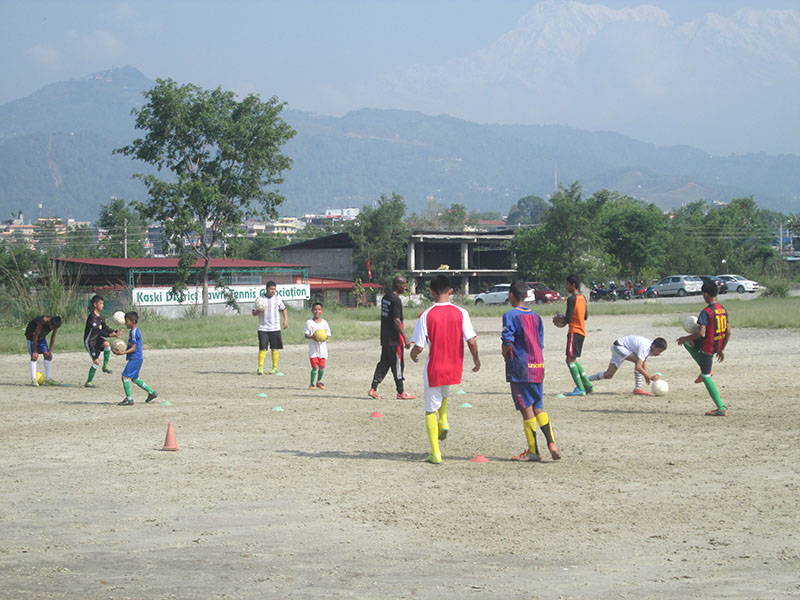 School going students playing football at the stadium, in Pokhara, on Friday, May 18, 2018. Photo: Rishi Ram Baral