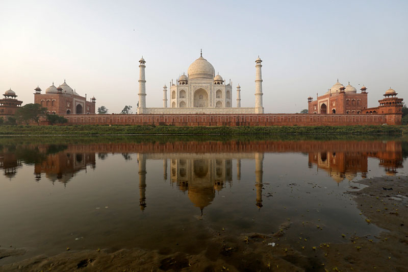 The historic Taj Mahal is pictured from across the Yamuna river in Agra, India, May 20, 2018. Picture taken May 20, 2018. REUTERS/Saumya Khandelwal