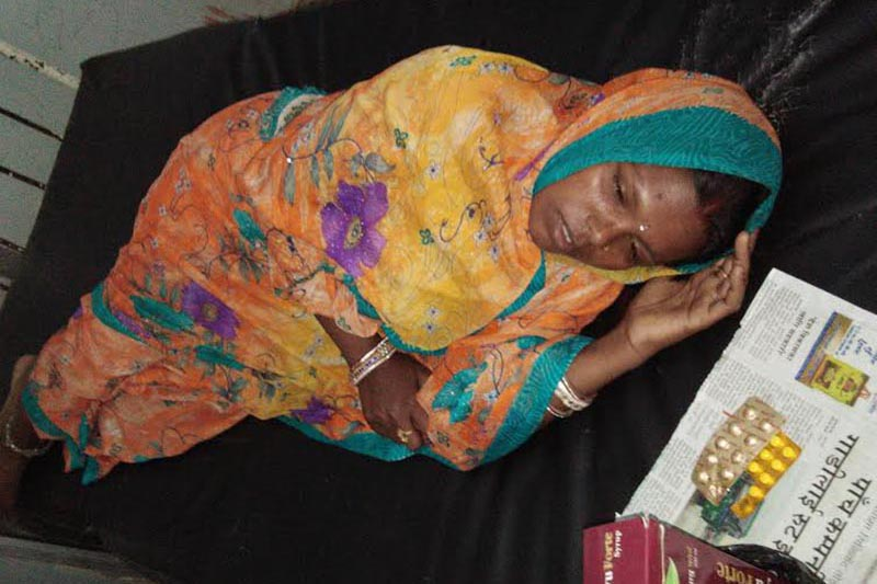 A woman, who was thrashed on the charge of witchcraft, being treated in Gaur Hospital, Rautahat, on Tuesday, May 22, 2018. Photo: THT