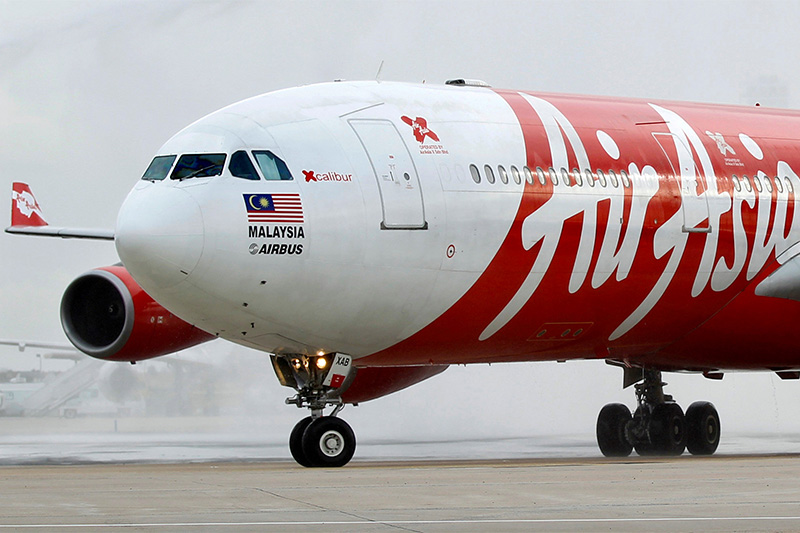 FILE PHOTO: An AirAsia X Airbus A340 passenger jet arrives on its inaugural flight from Kuala Lumpur to Paris Orly Airport February 14, 2011. Photo: Reuters