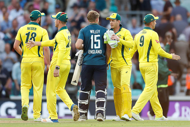 England's David Willey with Australia players after winning the match. Photo: Reuters