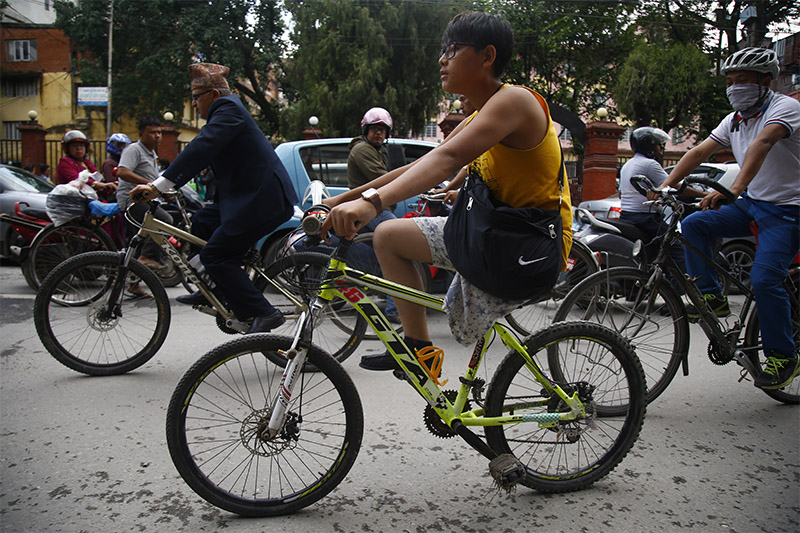 Yuvak Lama, 18, a differently-able youth pedals during a rally held to mark World Bicycle Day in Kathmandu, on Sunday, June 3, 2018.
