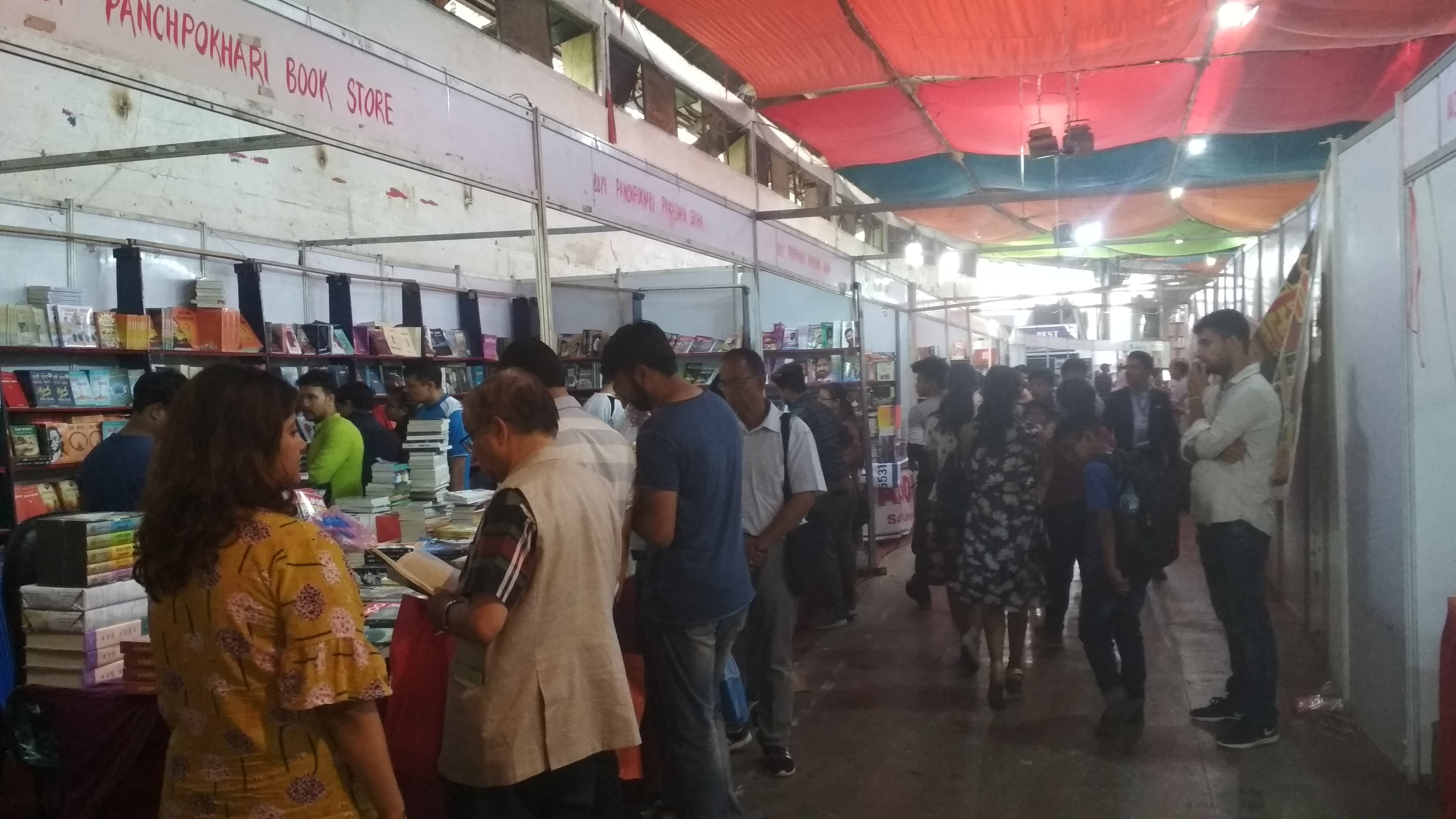 Visitors explore the stalls showcasing books and education materials inn22nd Nepal International nBook Fair organised by Global Exposition and Management Services Pvt Ltd, at Bhrikuti Mandap Exhibition Hall in Kathmandu, from June 1 to 9, on Saturday, June 9, 2018. Photo: Sureis/THT Online