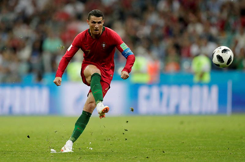 Soccer Football - World Cup -    Portugal's Cristiano Ronaldo scores their third goal from a free kick to complete his hat-trick  against Spain in Group B match of 2018 Football Fifa World Cup in Fisht Stadium, Sochi, Russia, on June 15, 2018. Photo: Reuters