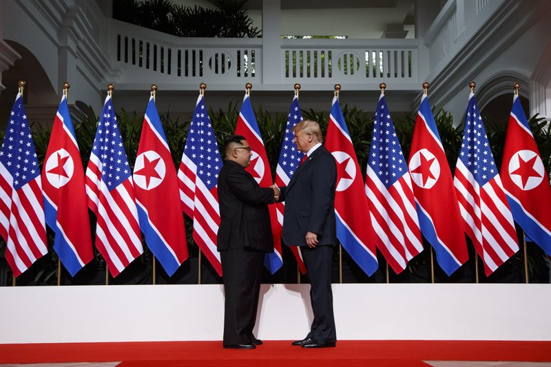 In this Tuesday file photo, U.S. President Donald Trump shakes hands as he meets with North Korean leader Kim Jong Un on Sentosa Island, in Singapore on June 12, 2018. Photo: AP