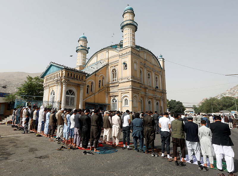 Afghans take part in morning prayers to celebrate the first day of the Muslim holiday of Eid al-Fitr, in Kabul, Afghanistan, on June 15, 2018. Photo: Reuters