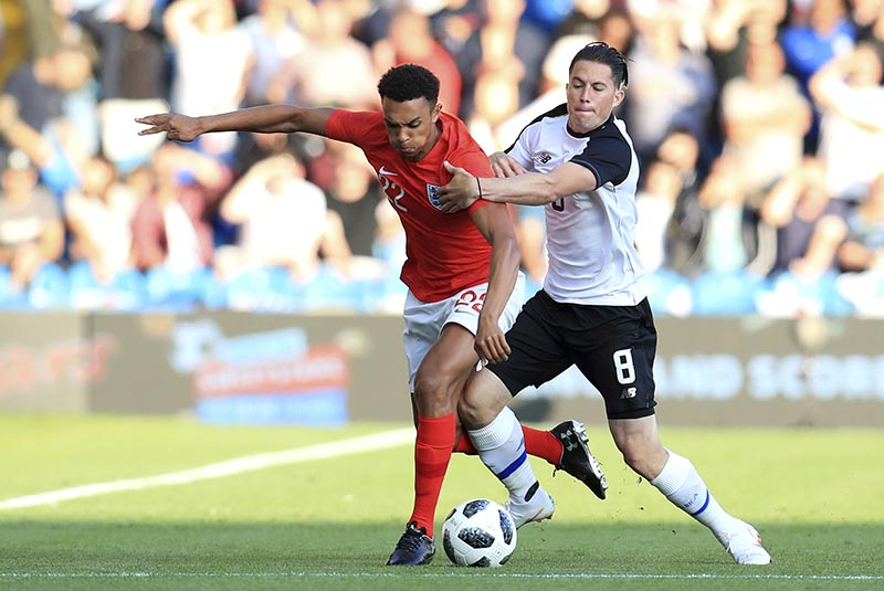 England's Trent Alexander-Arnold (left), and Costa Rica's Bryan Oviedo battle for the ball during their International Friendly soccer match at Elland Road, Leeds, England, on Thursday, June 7, 2018.  Photo: AP