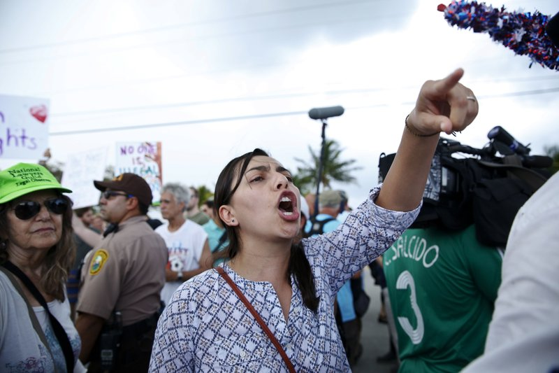 A protester yells toward a Trump supporter after arriving to the Homestead Temporary Shelter for Unaccompanied Children, on Saturday, June 23, 2018, in Homestead, Florida. Photo: APn