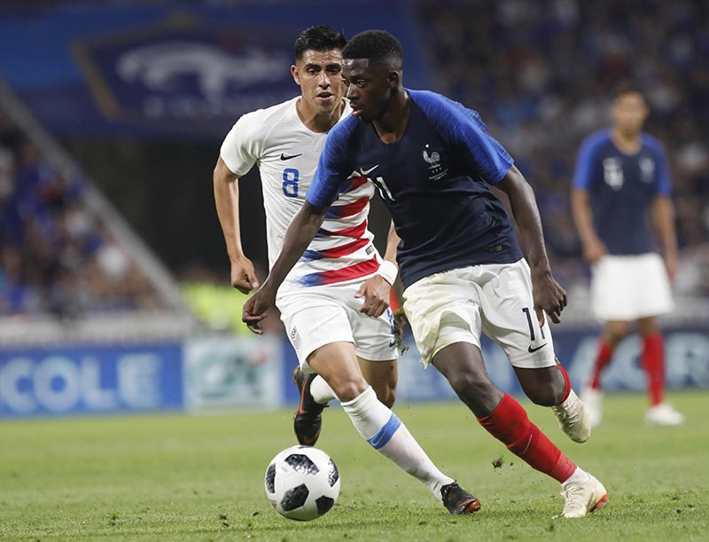 France's Ousmane Dembele (right), and United States' Joe Corona (left), follow the ball during a friendly soccer match between France and USA at the Groupama stadium in Decines, near Lyon, central France, Saturday, June 9, 2018. Photo: AP