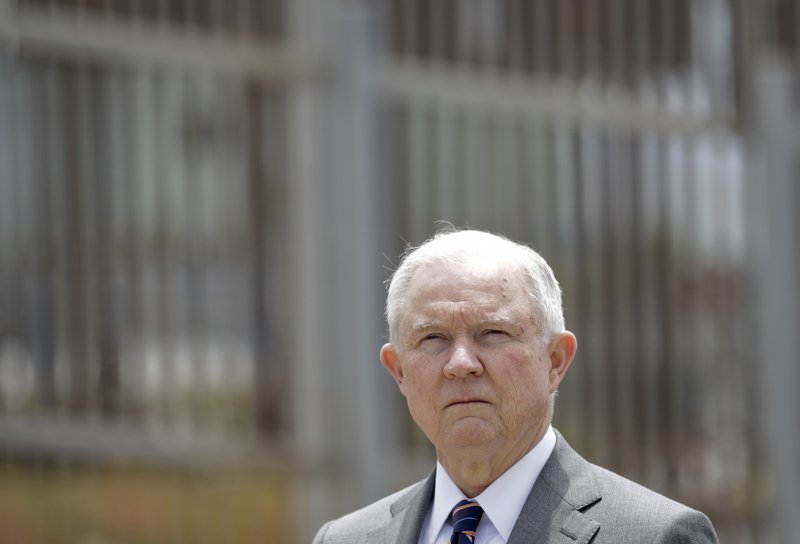 File - In this file photo, Attorney General Jeff Sessions listens during a news conference in San Diego near the border with Tijuana, Mexico on May 7, 2018.