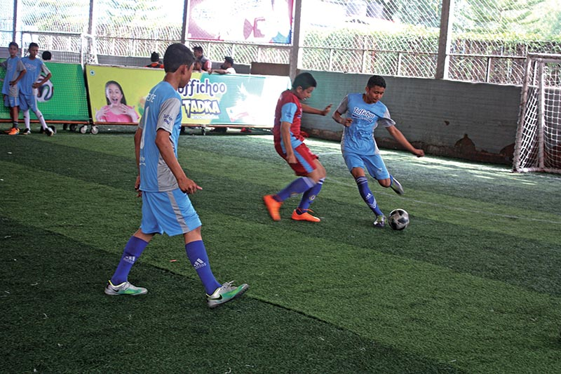 Players in action during the Toffichoo Junior Champions Cup Inter-school Futsal Tournament in Kathmandu on Wednesday.