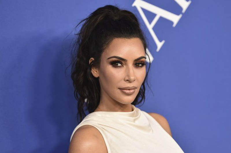 File-In this June 4, 2018 file photo, Kim Kardashian West arrives at the CFDA Fashion Awards at the Brooklyn Museum in New York.