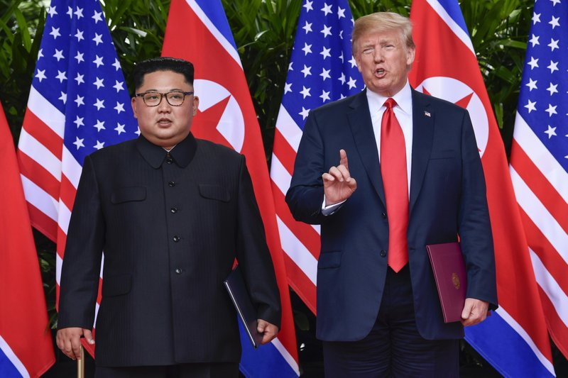 U.S. President Donald Trump makes a statement before saying goodbye to North Korea leader Kim Jong Un after their meetings at the Capella resort on Sentosa Island on Tuesday, June 12, 2018 in Singapore. Photo: APn