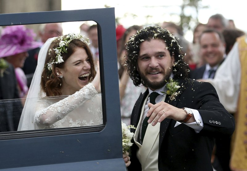 Actors Kit Harington and Rose Leslie react as they leave after their wedding ceremony, at Rayne Church, Kirkton of Rayne in Aberdeenshire, Scotland, on Saturday, June 23, 2018. Photo: AP