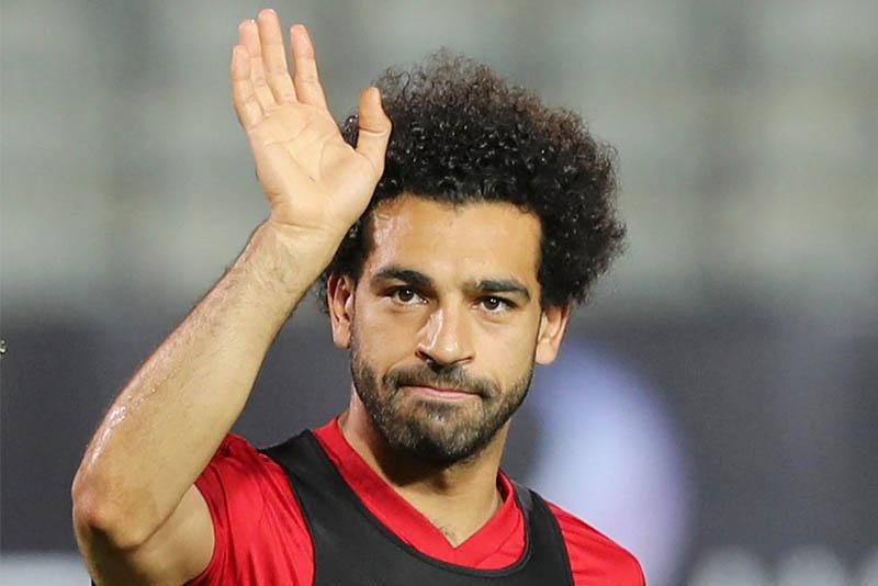 Egypt's Mohamed Salah waves for fans in Cairo international stadium in Cairo. Photo: Reuters