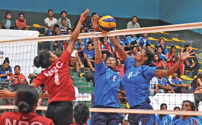 Action in the match between Nepal Police Club and Nepal APF (right) during the NVA-RBB Volleyball Tournament at the NSC Covered Hall in Kathmandu on Tuesday. Photo: THT
