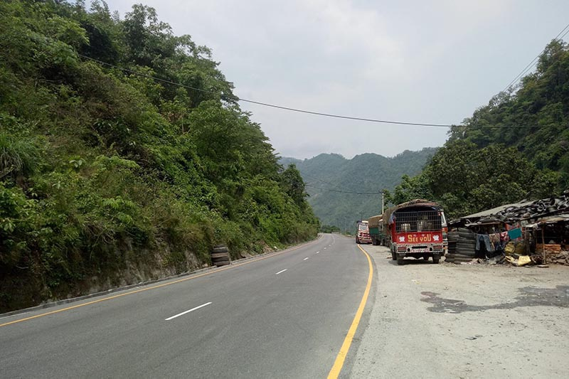 FILE - Two lorries and a truck are seen parked beside a road along the Narayangadh-Muglin road section, in Chitwan district, on Wednesday, June 6, 2018. Photo: Tilak Ram Rimal/THT